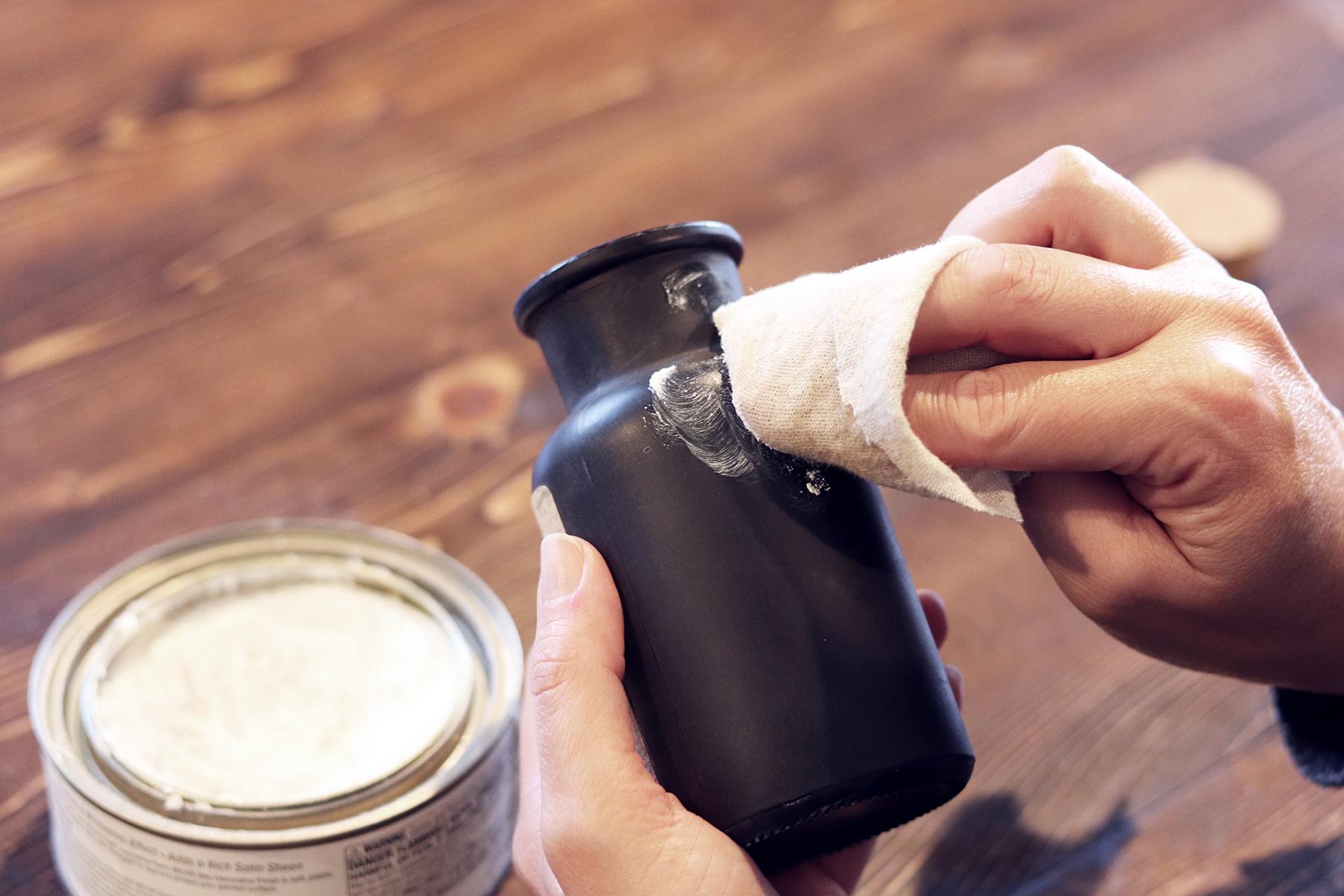 Boroughfare Applying White Wax to Bottle